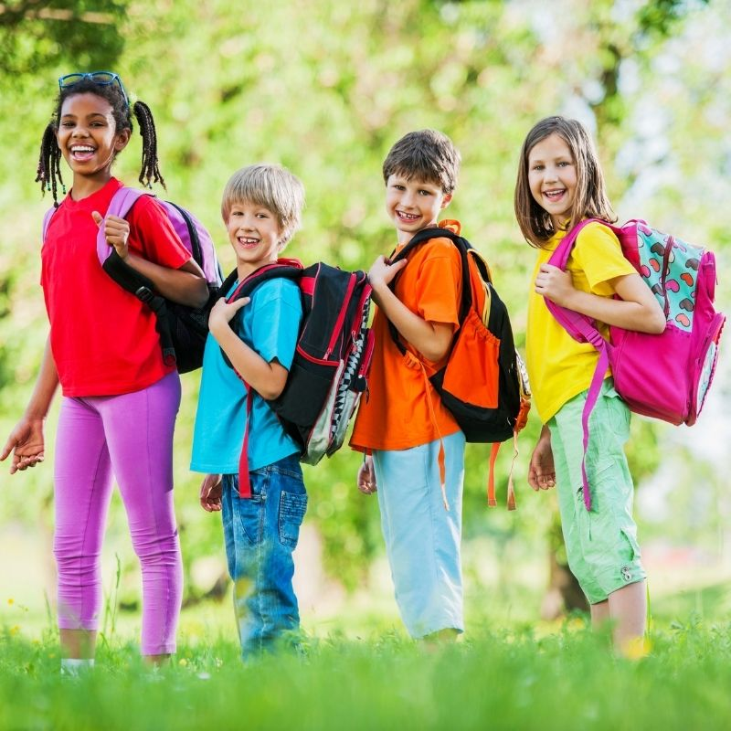 school children wearing properly fitted backpacks
