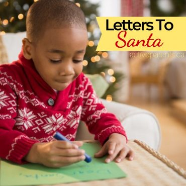little boy writing his letter to santa