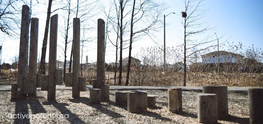 wooden play structures at hamilton parkette