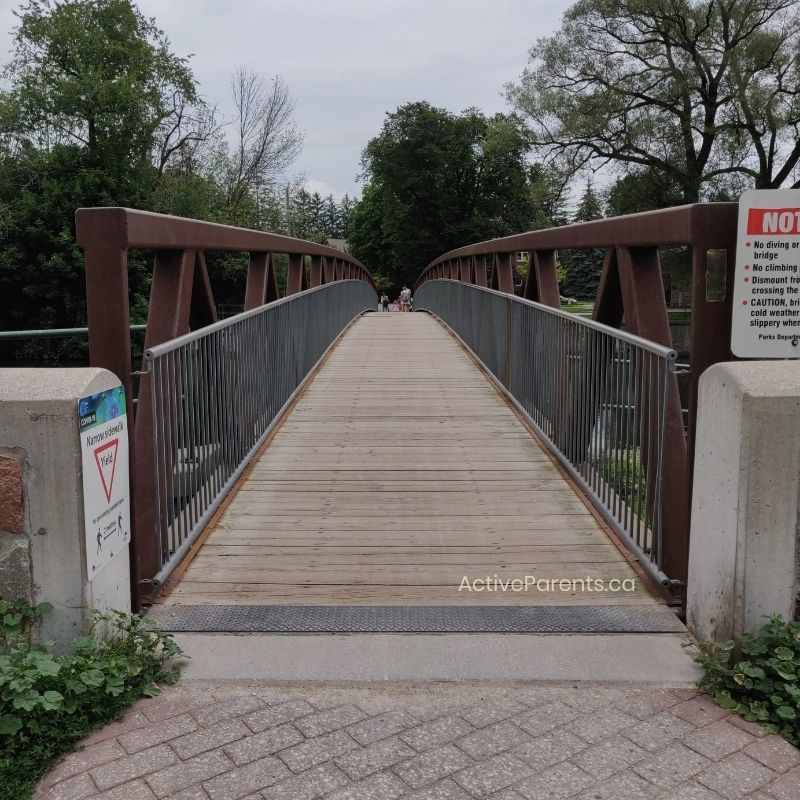 A view of the pedestrian bridge at riverside park over the speed river