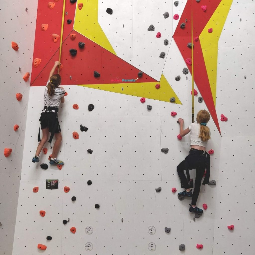 two girls Auto Belay climbing at The Hub in Mississauga