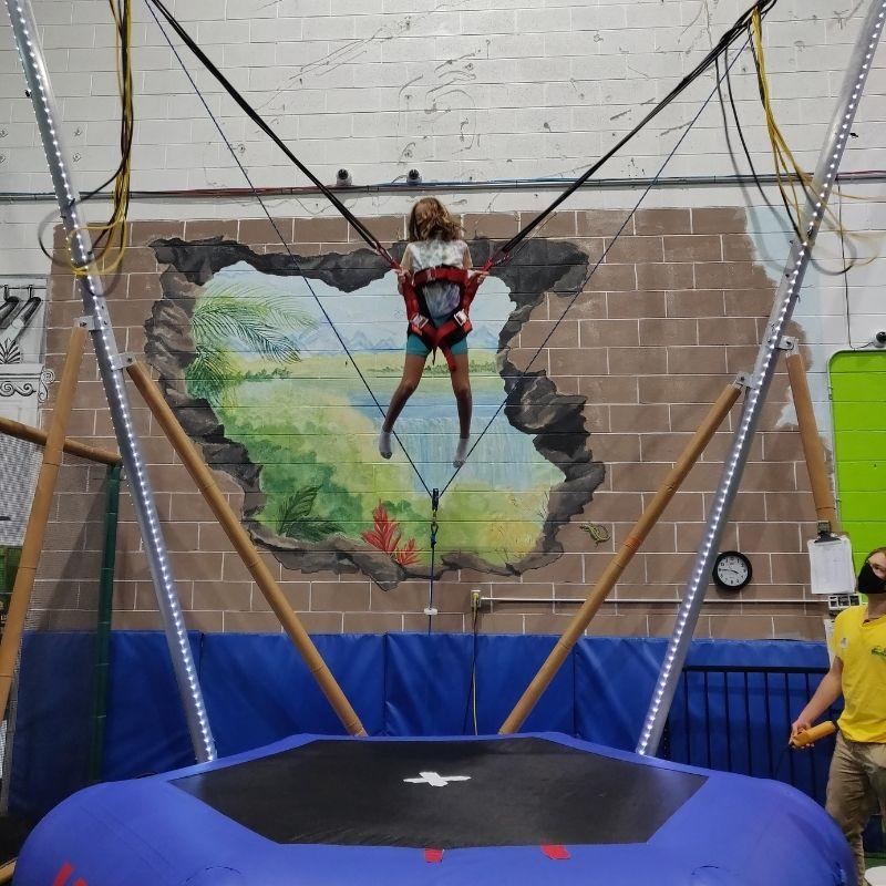 bungee trampoline in action at lil monkeys burlington playground